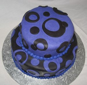 16th Birthday Purple and Black Circle Birthday Cake