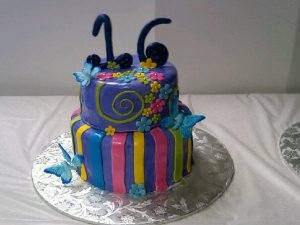 Sweet 16 Birthday Cake with Butterflies Pink, Purple, Blue, Yellow, and Green