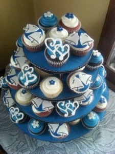 Interlocking Hearts, Wedding Bells, and Navy Blue Flowers on a tiered Cupcake Tree provided by Bear Heart Baking Company