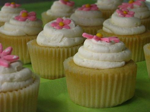 Yellow Cupcakes with Black Raspberry Filling and Lemon Buttercream icing!