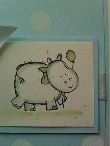 Close up of hippo invitation for baby shower party
